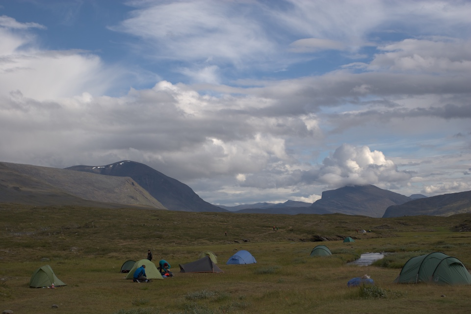 Tents scattered in the valley