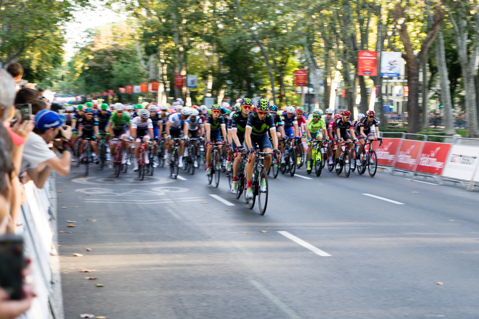 Peloton running it's first lap on Paseo del Prado (Madrid)